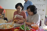 Volunteer Chun-Li Yang at Taiwanese table