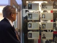 Veteran Bing Wong looks over photographs of his fellow Chinese-Canadian soldiers from WWII