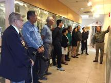 Veteran Bing Wong along with PCHC Volunteers, Members, and Directors, listens to a private tour of new exhibition with CCMS President King Wan