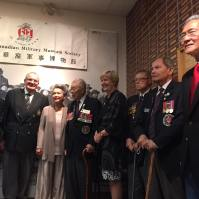 WWII veterans stand together for photos