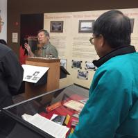 Volunteers and New Members Richard and Ken listen to private tour of new exhibition with CCMS President King Wan